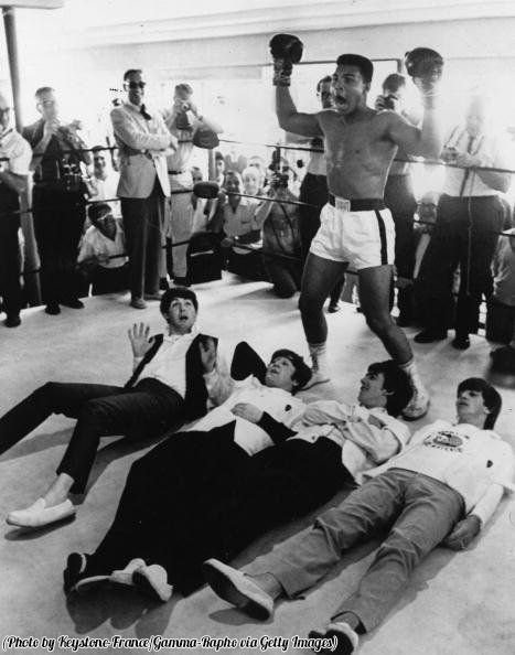 #MusicMoments: American heavyweight boxer Cassius Clay in a mock victory pose over The Beatles, 1964. #TheMusicSite
