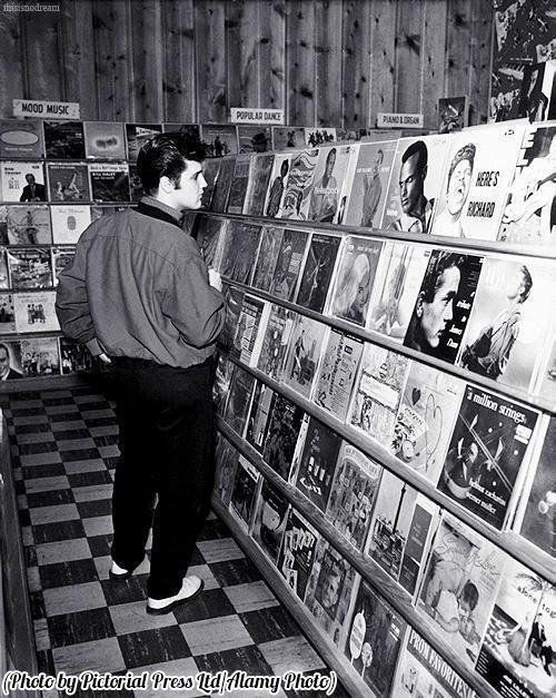 #MusicMoments: Elvis checks the competition at a Memphis music store, 1957. #TheMusicSite