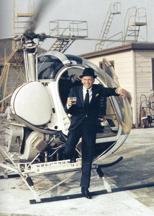 #MusicMoments: Making an entrance. Frank Sinatra stepping off of a helicopter with a drink in his hand, 1964. #TheMusicSite