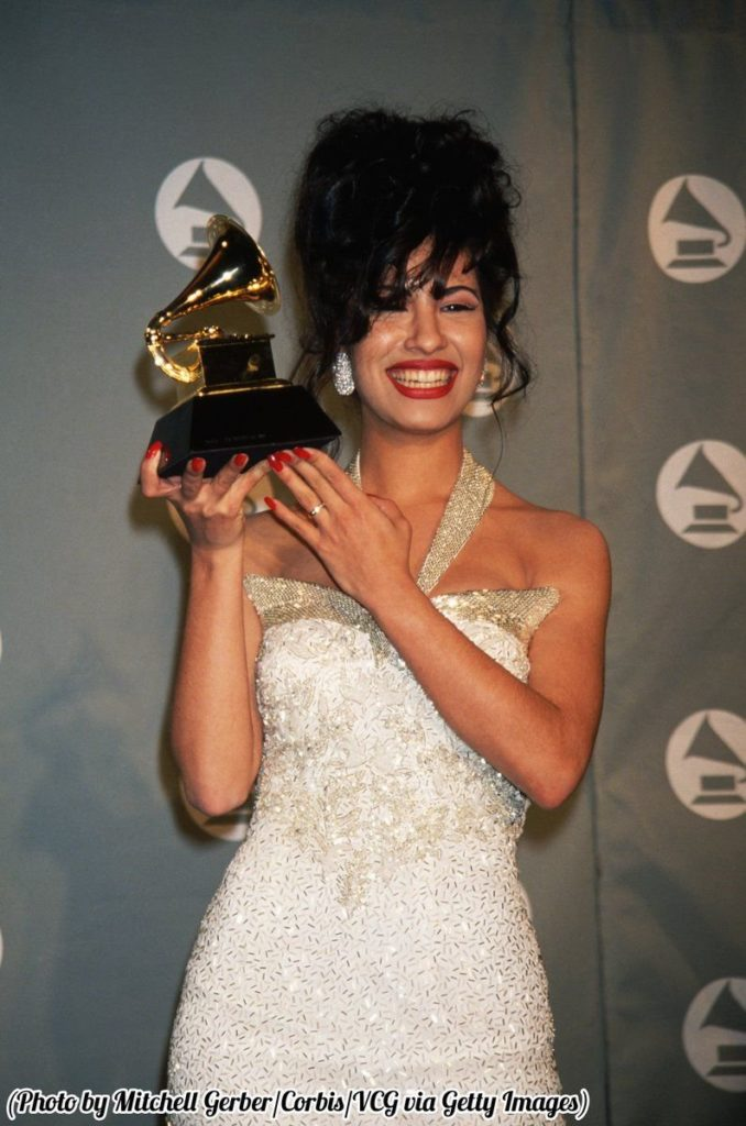 #MusicMoments: Selena holding her Grammy at the 1994 awards show. #MusicMoments: The Red Hot Chili Peppers. #TheMusicSite